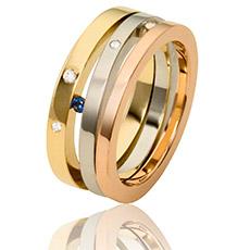 Bijzonder sieraad in drie kleuren goud met saffier en briljanten