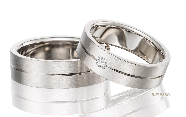 Unieke trouwringen in 14 karaat witgoud met diamant princess van 0,08 crt vvs/tw