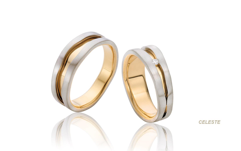 bicolor trouwringen handgemaakt van wit en geelgoud met een briljant in de damesring