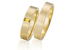 gouden trouwringen met gele saffier