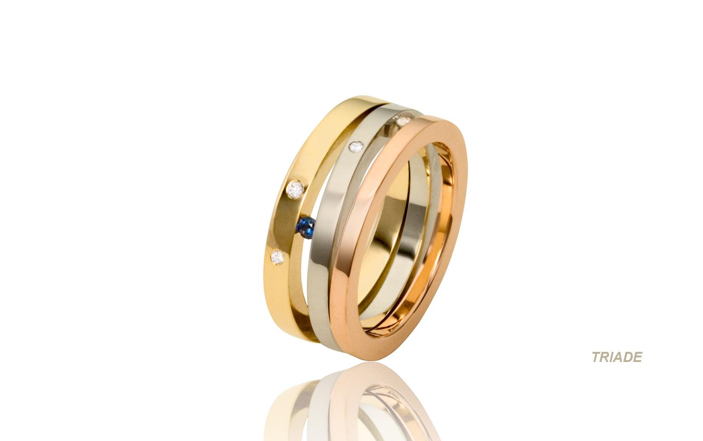 14 karaat tricolor trouwringen met saffier en briljanten totaal 0,09 carat